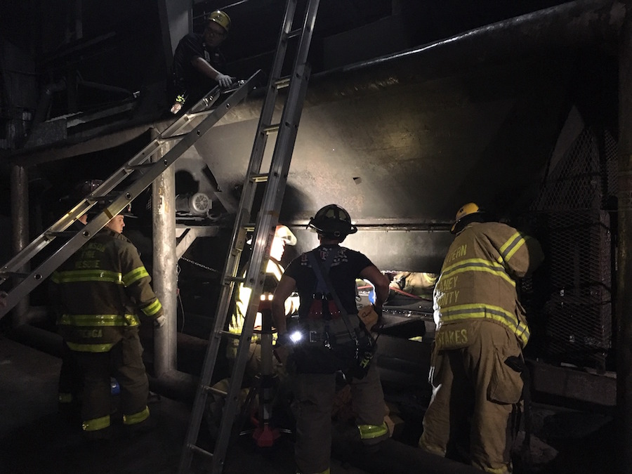Crews Free Worker from Auger at Charcoal Plant | Powder/Bulk