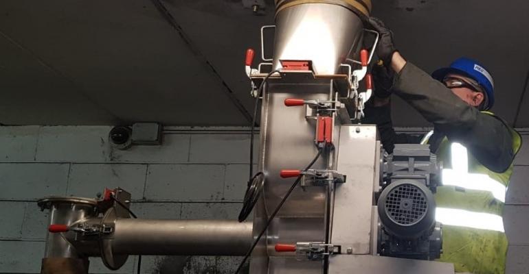 Ajax installing the stainless steel agitated screw feeder onsite