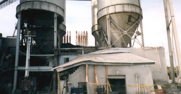 Hopper dropped off silo at left resulting in death of two workers in lab that had been located in building directly beneath