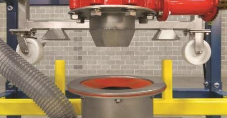 The stainless steel surge hopper with gasketed receiving ring is vented to a Bag-Vac dust collection system that puts the sealed system under vacuum, preventing the escape of displaced air and dust.