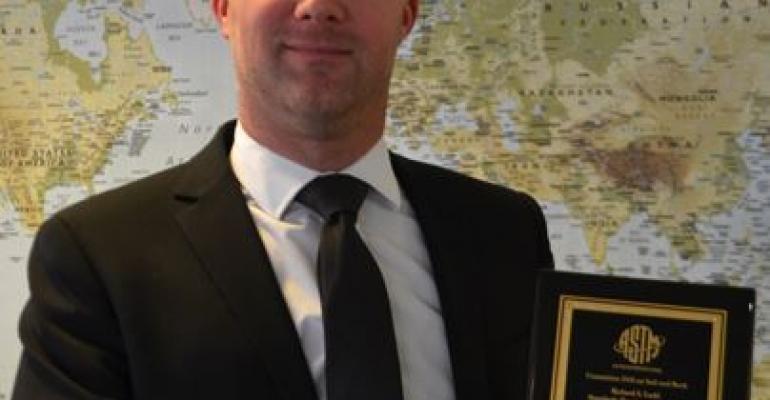 Tim Freeman was presented with the Richard S. Ladd Standards Development Award