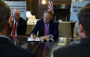 U.S. Environmental Protection Agency (EPA) Administrator Scott Pruitt signing the proposed rule on chemical plant RMPs. Image courtesy of EPA