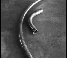 Four-in. pipe elbows. Long radius (on left) vs. short radius (on right)