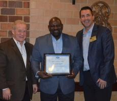 Michael Moses accepting safety award with FMA members.