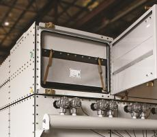Integrated safety monitoring filters installed atop a dust collector