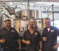 From left to right: Dave Behling (chief electrical engineer), Robert Patrie (operations manager), and Kurt Schneider (co-owner) create spirits and craft beers.