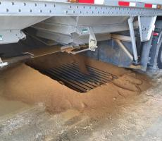 Grain loading grating that leads to underground conveyor into the feed mill in Otterburne, MB