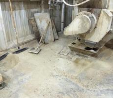 Typical situation on a production floor in the mill tower for a feed mill. These types of messes are representative of the requirement for general housekeeping.