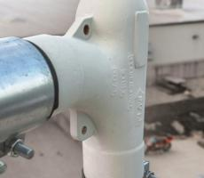 Gasketed couplings connect pneumatic lines to the socket-weld deflection elbows.