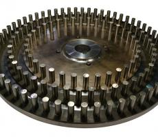 Figure B: A pin mill rotor with three concentric rows of pins which is used for aggressive milling applications