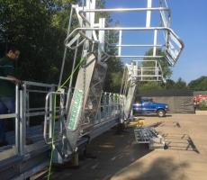 A large stationary platform fitted with tracking gangways and flared bottom rail safety cages.  This system will be used in the salt industry to be able to accommodate bulk trucks with multiple domes.