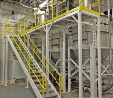 These 300-cu-ft material receivers are part of a pneumatic conveying system that transfers powders in a large-scale candy making process.