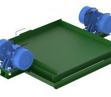 Rotary electric vibrators on vibratory compaction table