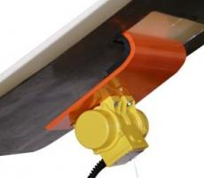 The Martin Vibrating Dribble Chute prevents carryback released by secondary conveyor belt cleaners from sticking to the rear slope of the discharge chute.