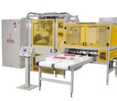 The Hamer-Fischbein Model 1800 RBH robotic bag hanger