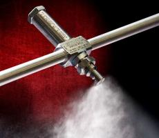 Exair's patented 1/4 NPT No Drip Internal Mix deflected flat fan atomizing spray nozzle
