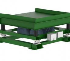 Vibratory table with weigh scales